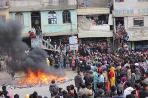 The angry mob burnt the commodities of the shopkeeper